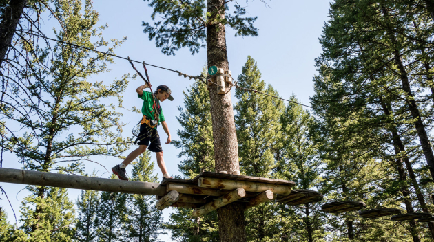 Traveler walking on a high ropes course
