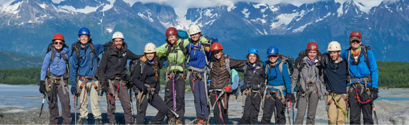 Traveler group photo all with rock climbing helmets and gear on