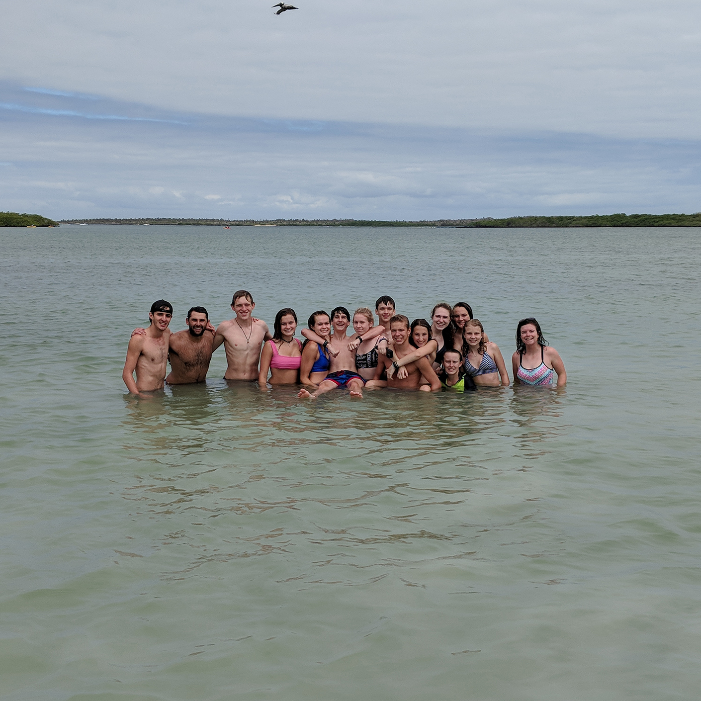 Group of travelers in the water on the Costa Rica trip