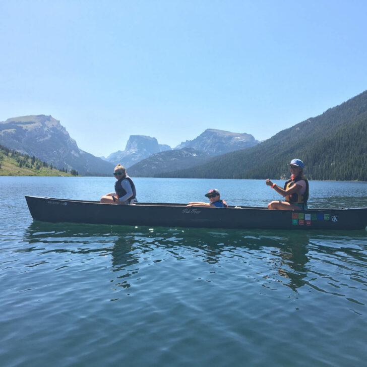 Travelers canoeing in a lake