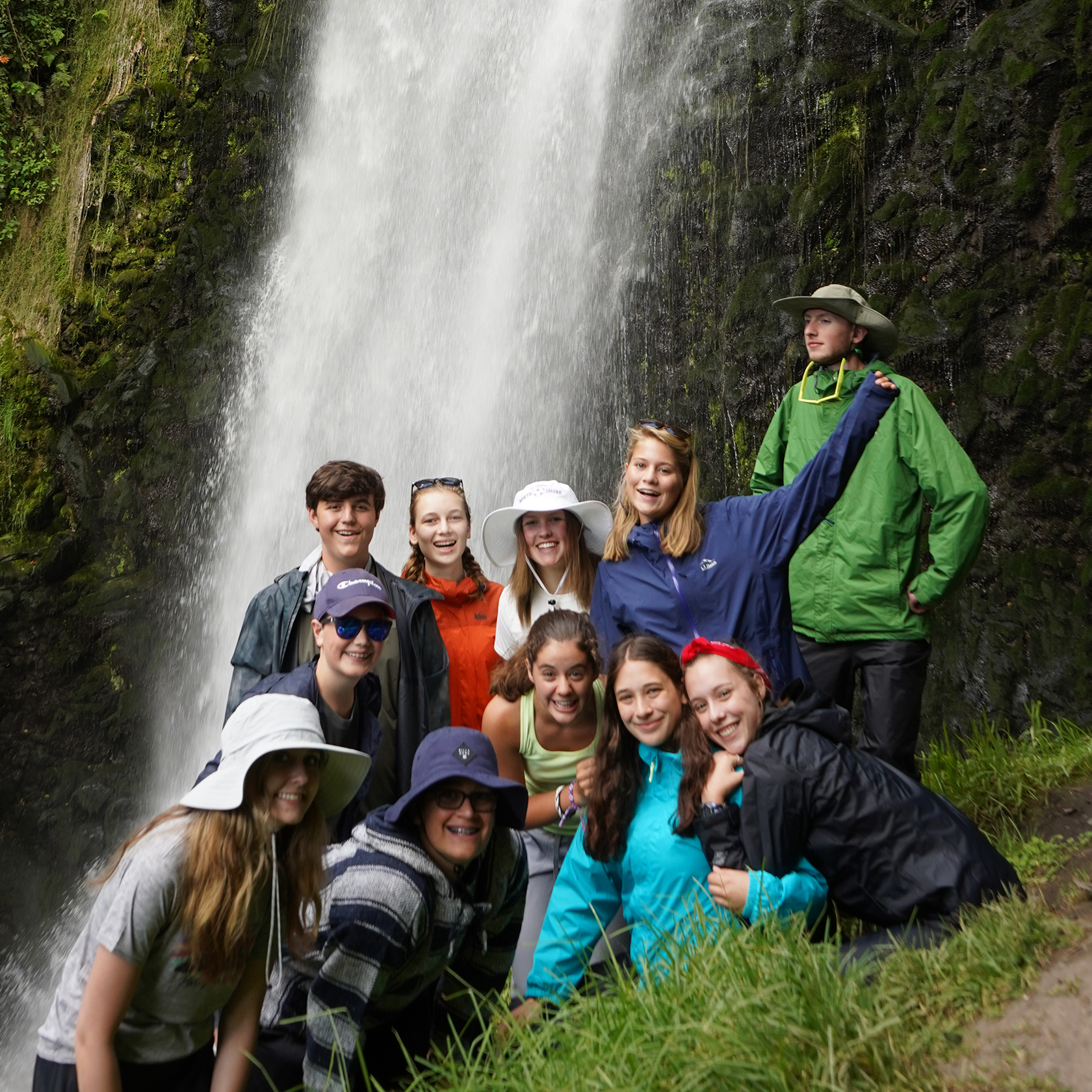 Group of travelers in front of a waterfall on the Ecuador Galapagos trip