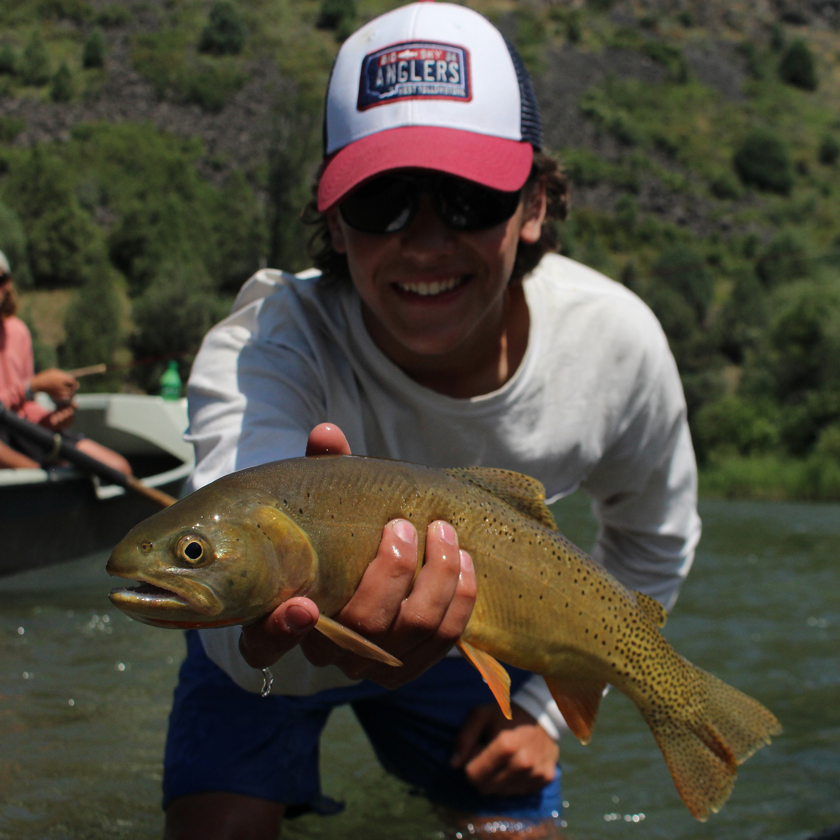 Traveler holding a fish on the Montana Fly Fishing trip