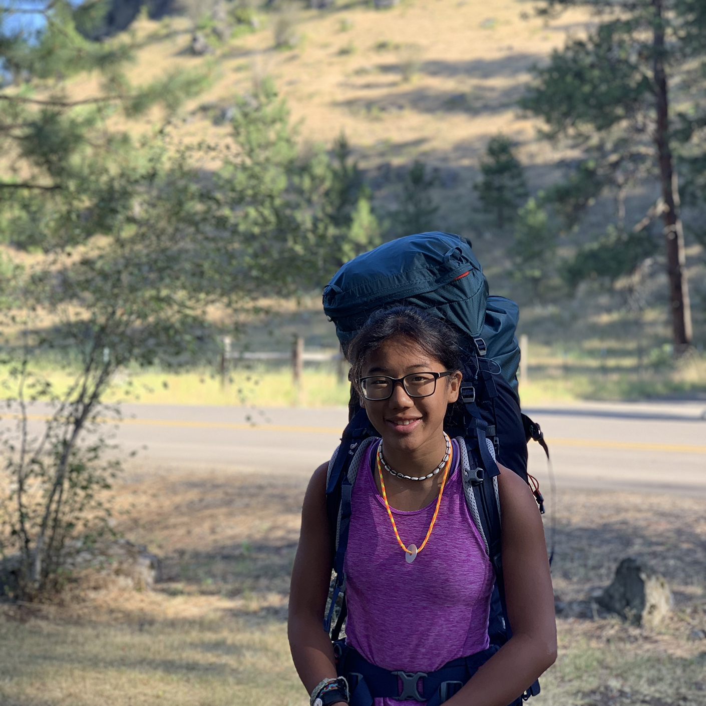 Traveler with backpack on the Pacific Northwest Explorer trip