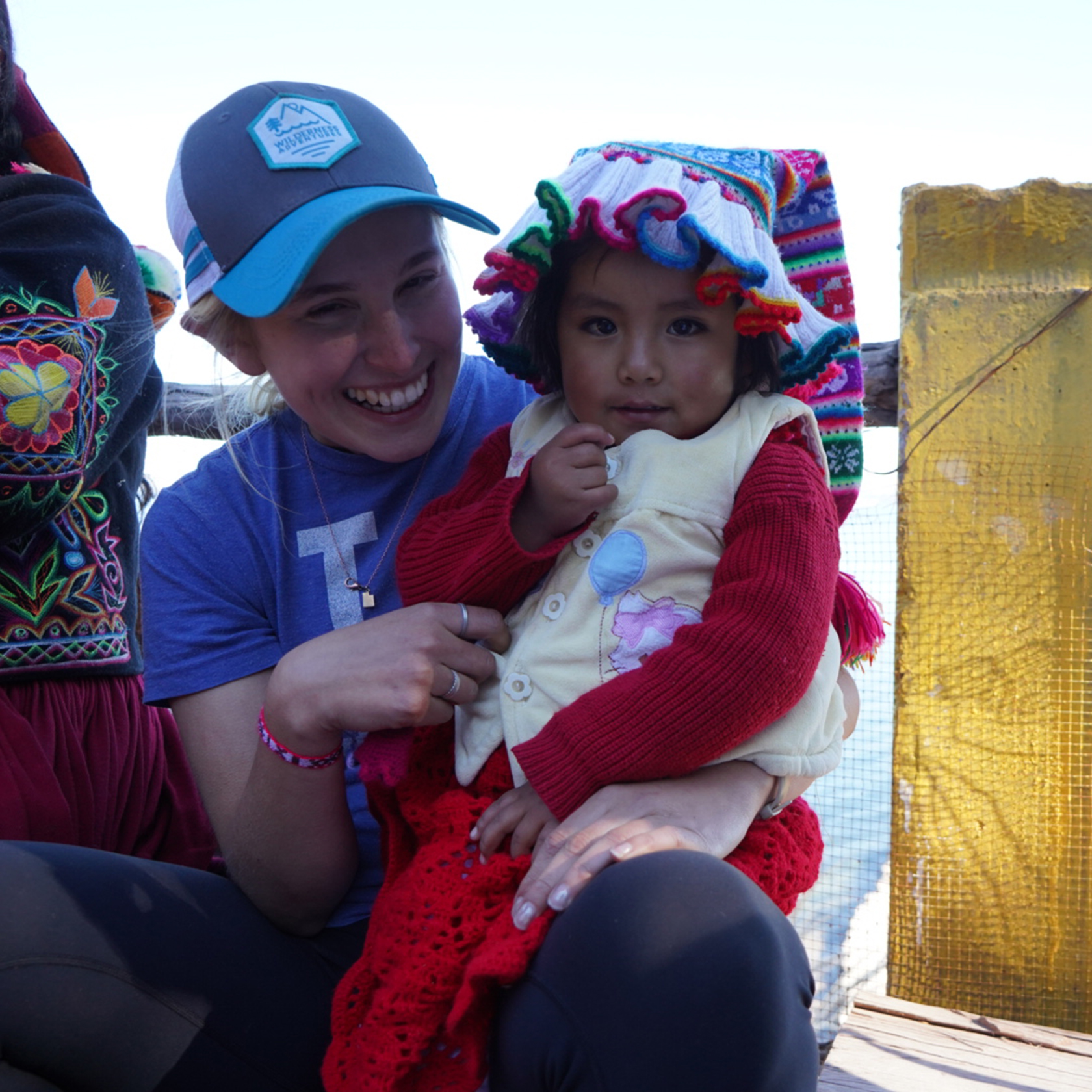 Traveler with a local Peruvian girl