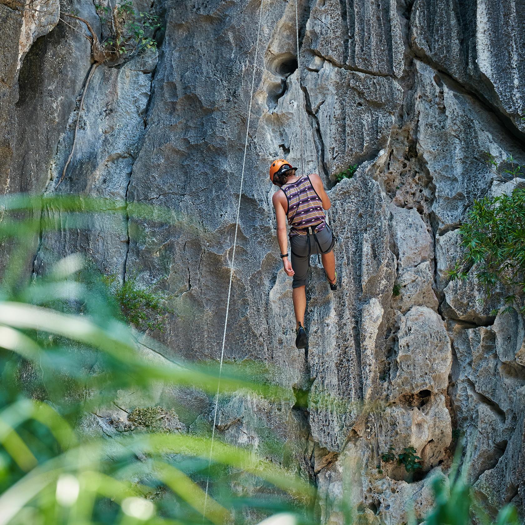 Traveler rock climbing