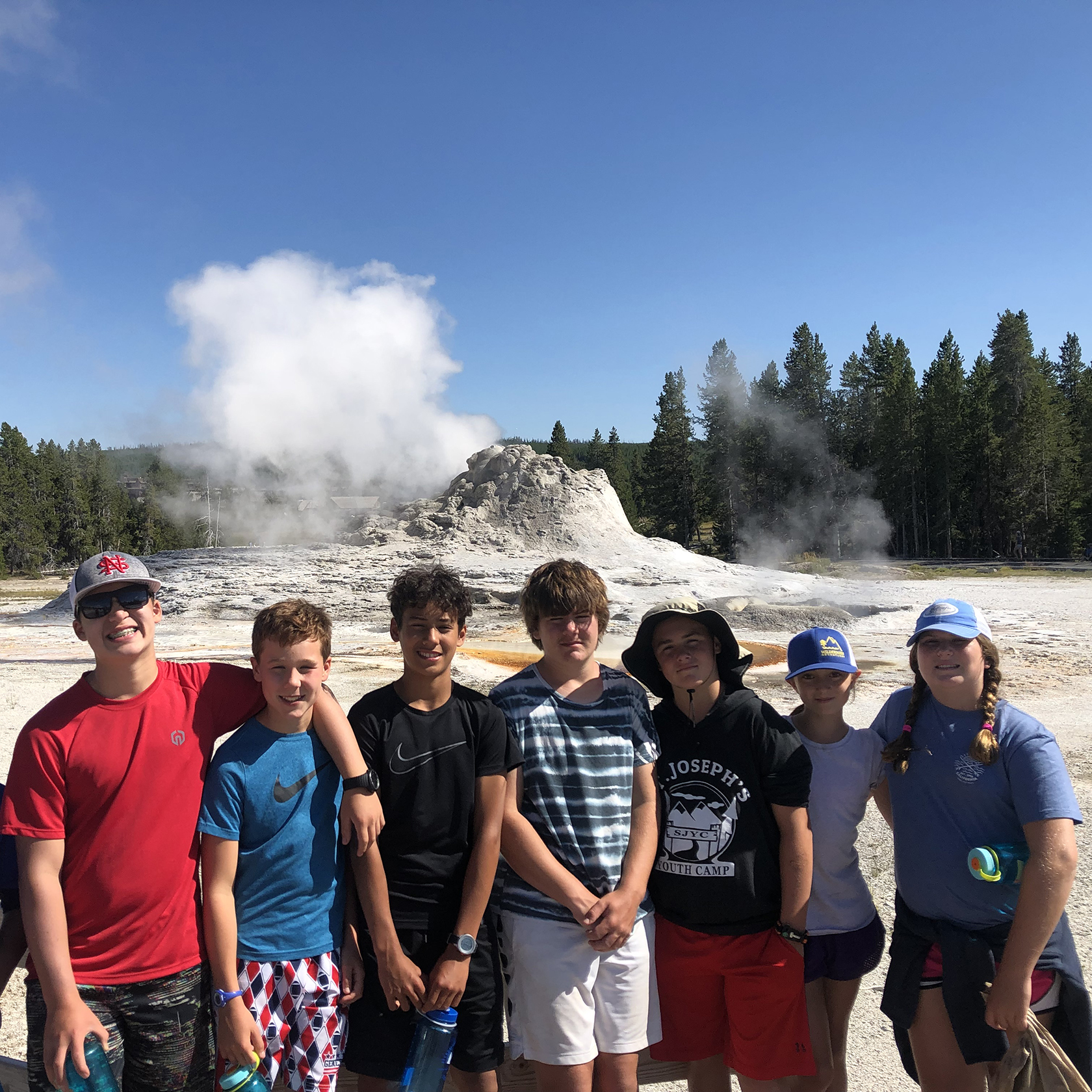 Travelers at Old Faithful in Yellowstone