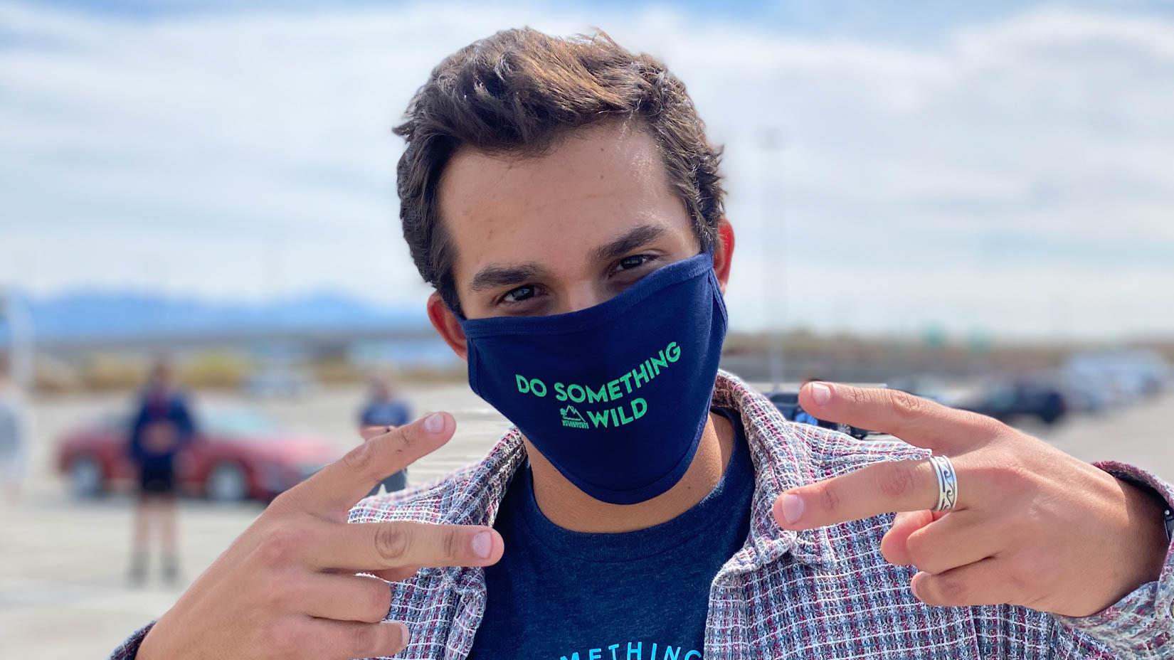 """Traveler wearing a """"Do Something Wild"""" mask"""
