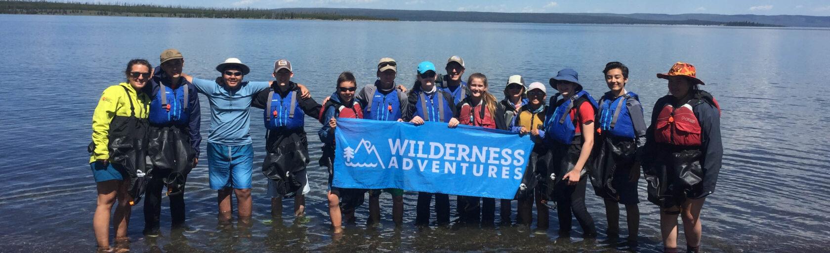 Yellowstone Explorer group photo with the WA flag