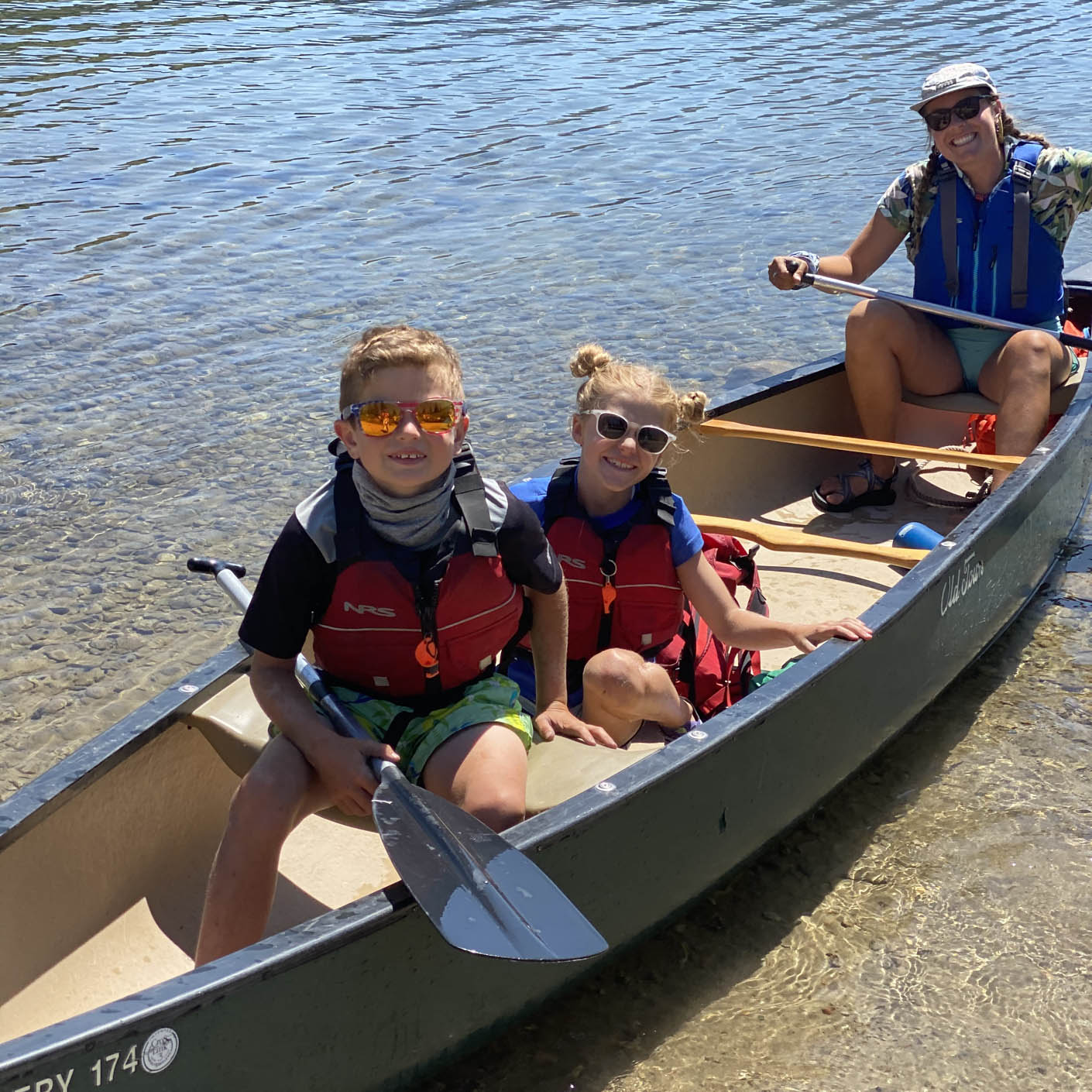 Young kids in a canoe