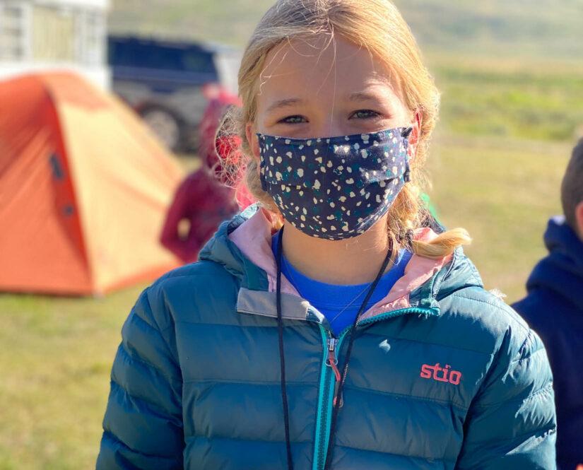 Girl traveler wearing a mask