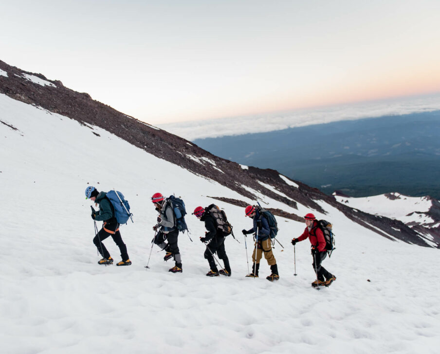 Travelers hiking up Mount Shasta in the snow