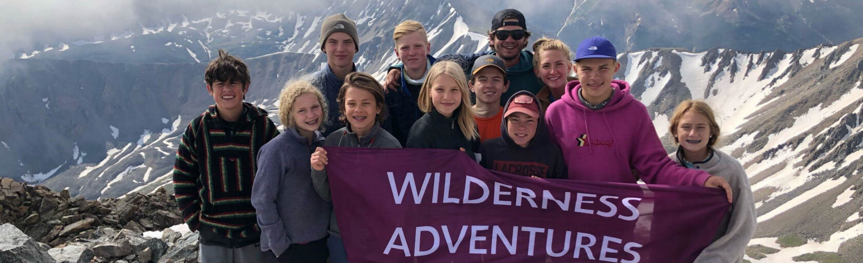 The Rockies Adventurer group with WA flag