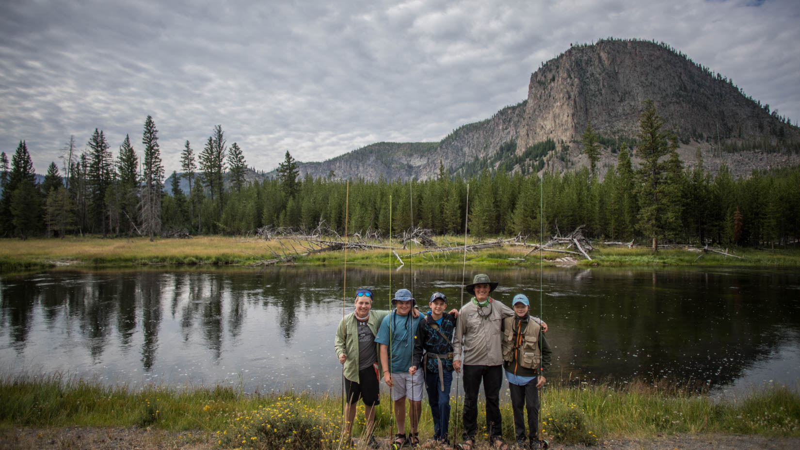 Group of travelers by a lake in Yosemite