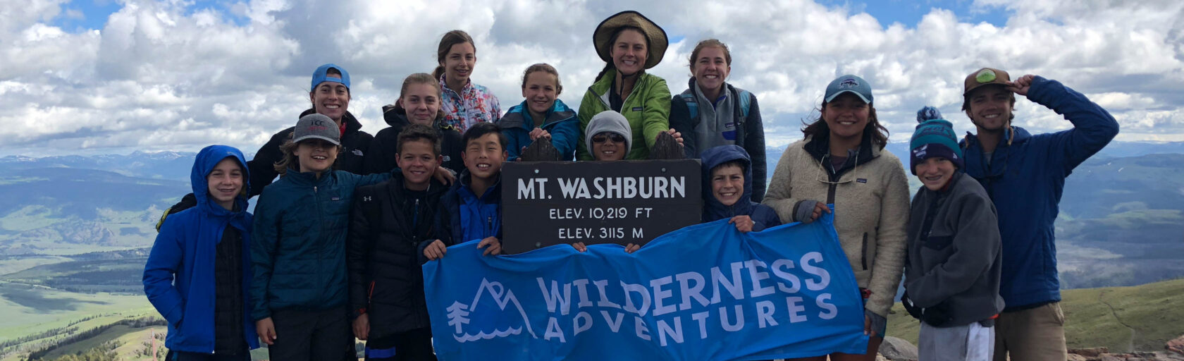 Yellowstone Teton Discovery group photo with WA flag