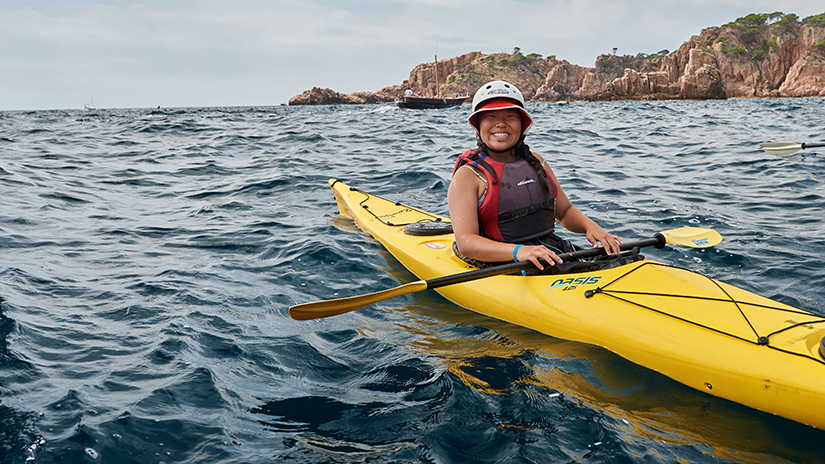 young girl kayaking
