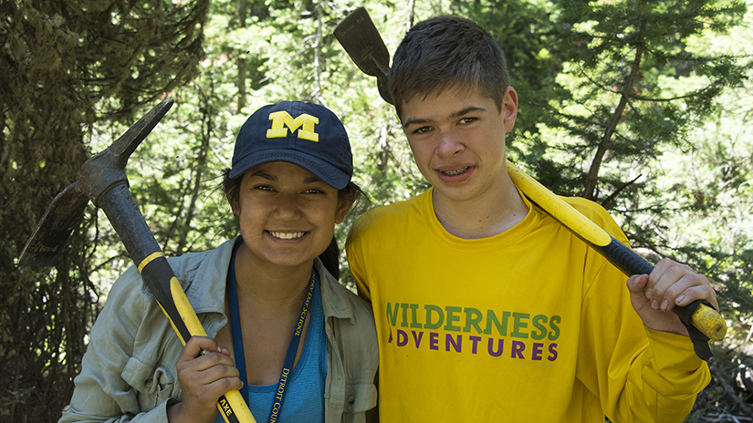 two young boy and girl camper posing during a hike