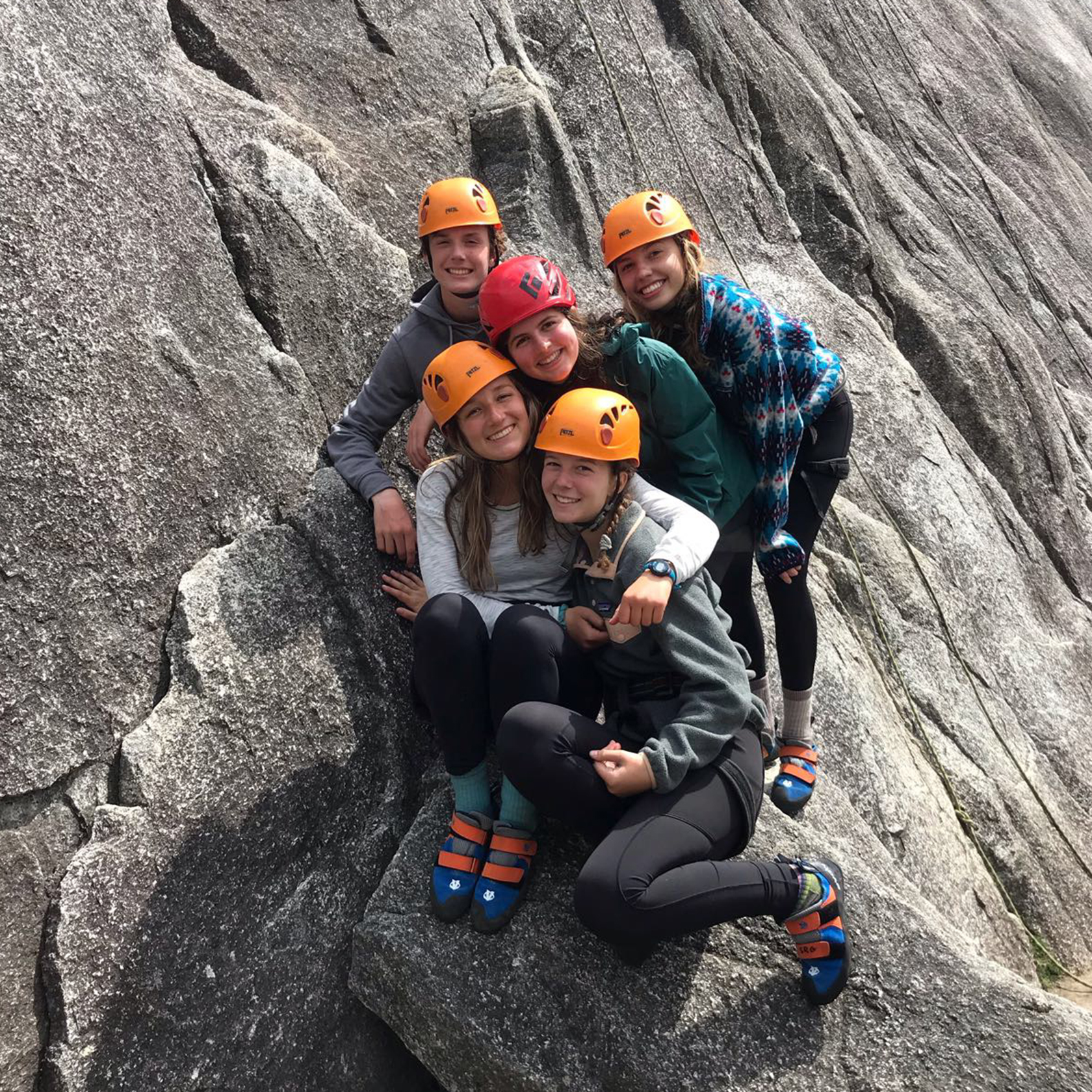 Group of girls wearing helmets to rock climb